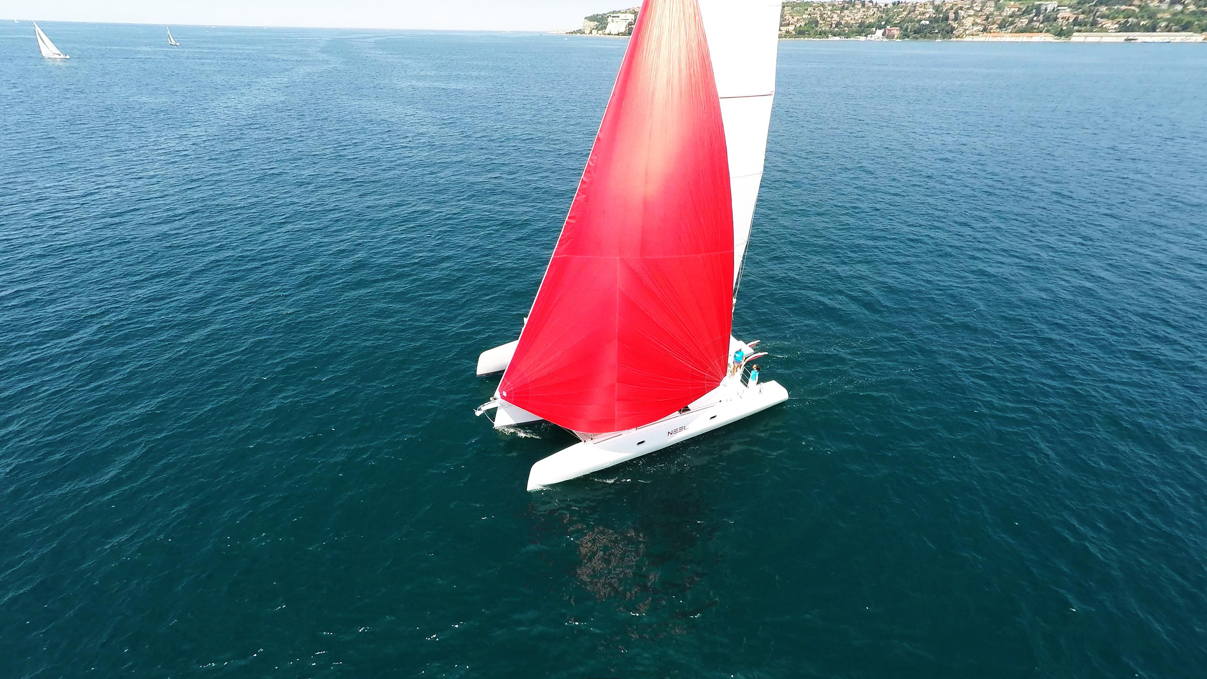 rosso gennaker turchese equipaggio bianco barca a vela neel 45